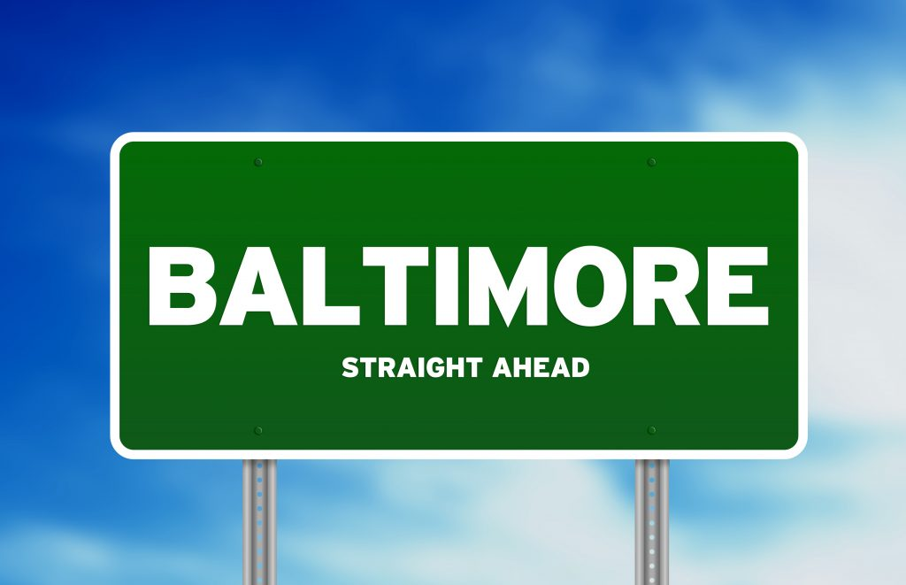 Green Baltimore, Maryland, USA highway sign on Cloud Background.